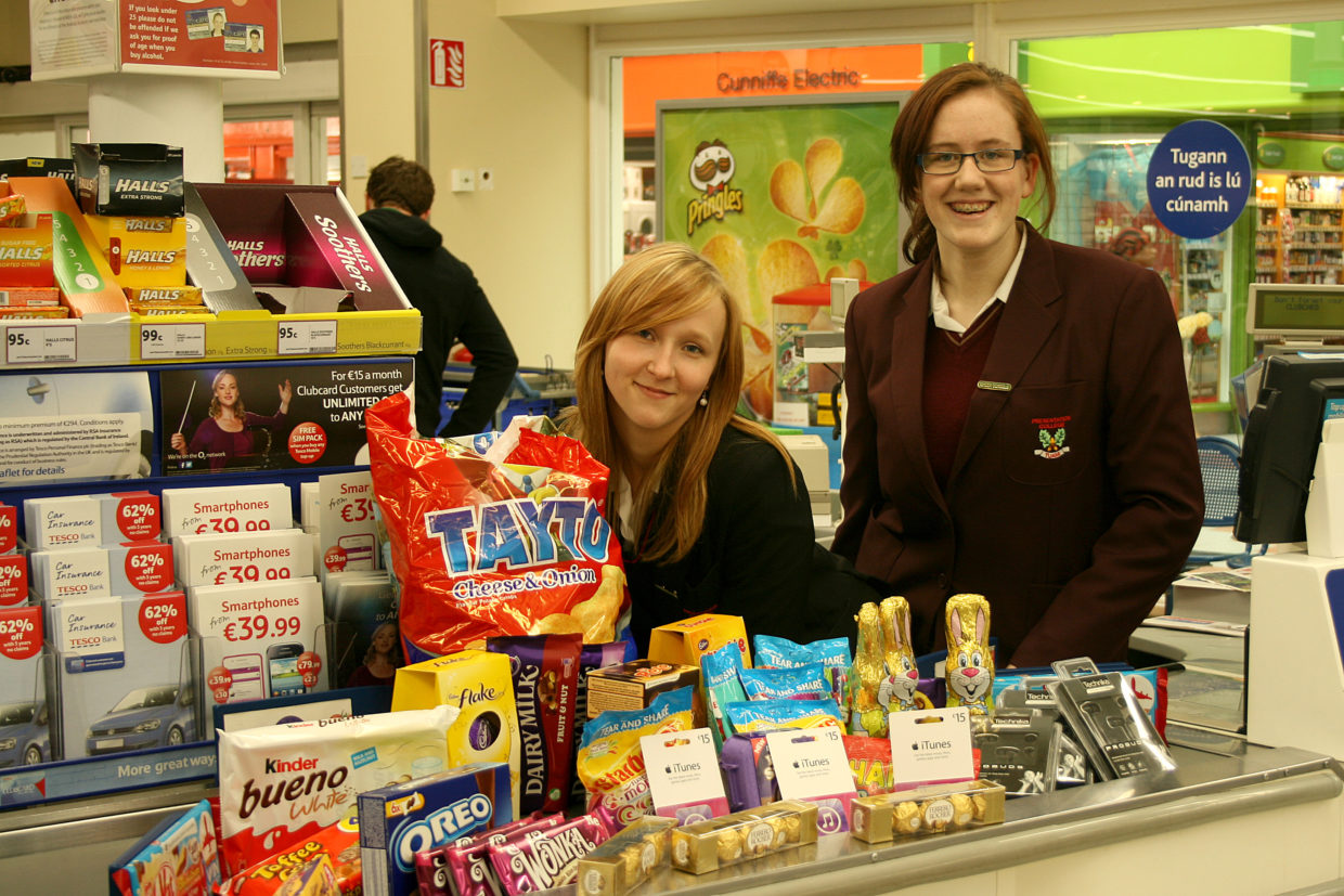 Jennifer Mannion & Magdalena Grochola of the Pres Currylea Green Schools committee with some of the €300 worth of goods sponsored by Tesco for their Green Schools promotions.