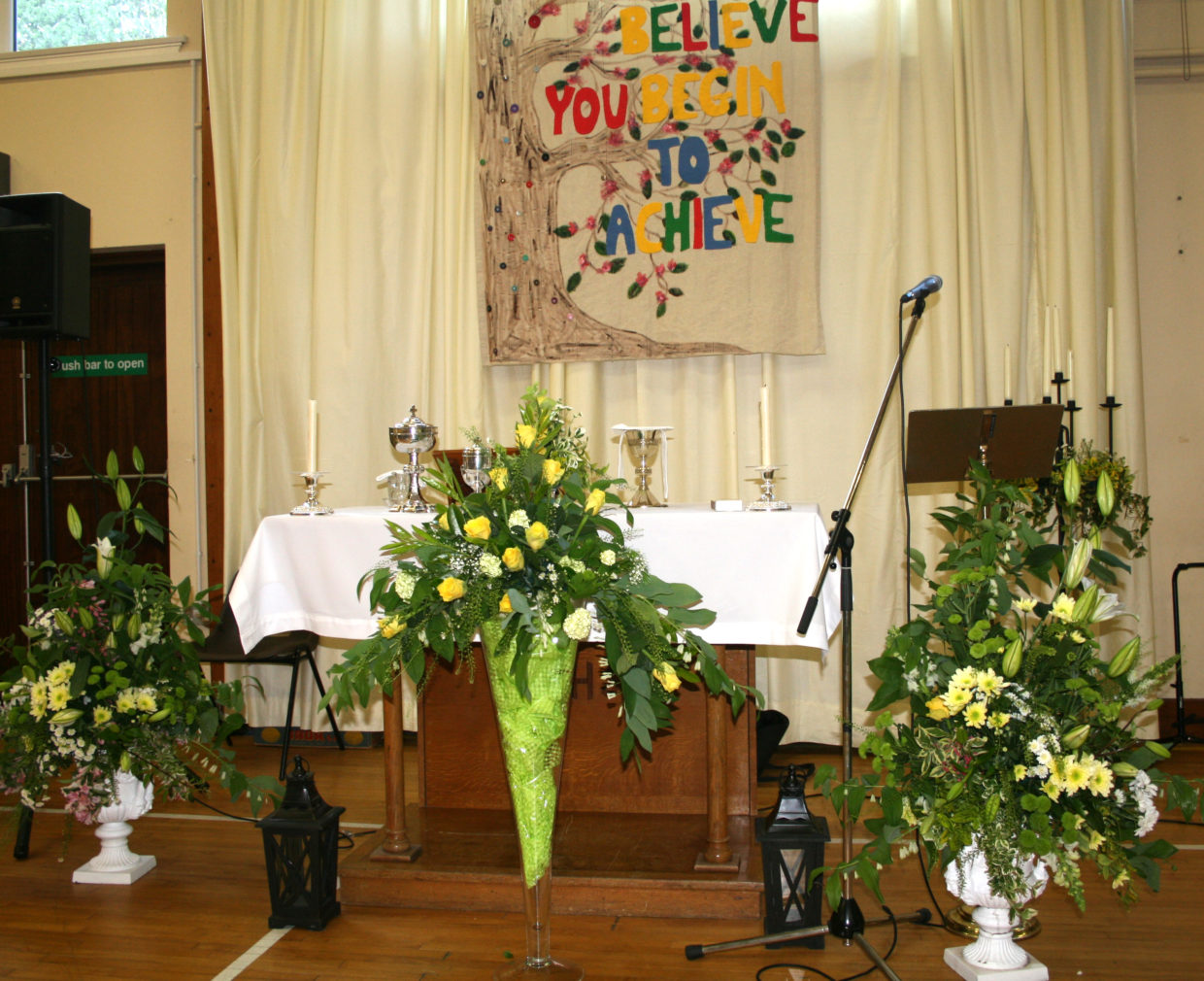 This photograph represents the tranquillity and serenity of our beautifully prepared alters, hanging tapestry, and floral arrangements, prior to the commencement of our Graduation Mass.