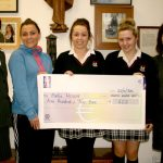 Anne Kelly the school's Sports Captain, PE teacher Gillian O'Connor and the school counsellor Ber Jordan presented the cheque for over four hundred euro to the representative from Pieta House.
