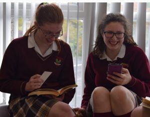 The girls enjoying their books and discussing the book's genre, themes and their favourite characters.
