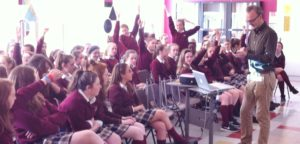 Irish Water Rep Colm Claffey demonstrates the use of interactive mobile phone  technology, as the girls learn about the process of turning wastewater into consumable drink.